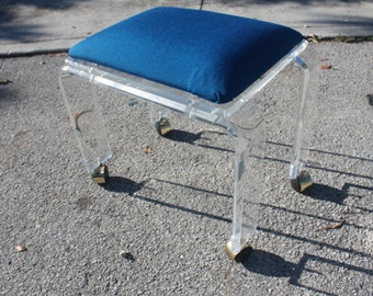 Vintage Lucite Vanity Stool With Navy Blue Cushion On Casters.