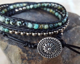 3 wrap genuine leather beaded bracelet with silver ornate closure.