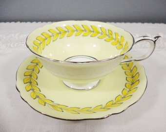 Paragon Queen Mary Yellow Laurel and Silver Bone China Teacup and Saucer