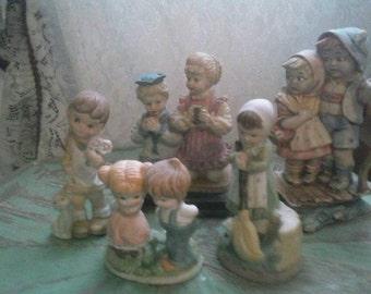 Set of 5 vintage figurines of children