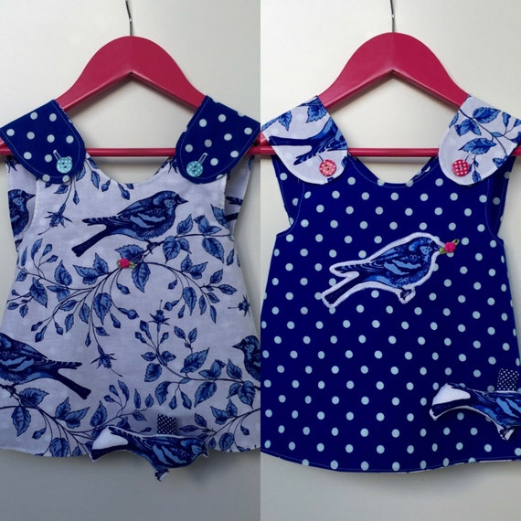 Summer Sale! -20% Double sided reversible baby girl pinafore Delft blue sparrow and polka dots with a toy rattle bird attatched. size 80