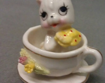 Cat in Cup and Saucer Figurine