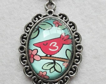 Girls necklace, with sweet little bird illustration in pendant with glass