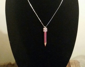 Shiny pink pencil necklace with rhinestones. Perfect gift for teachers and students!