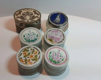 Collection of 6 small Avon cream sachet jars, cut glass with decorative tops
