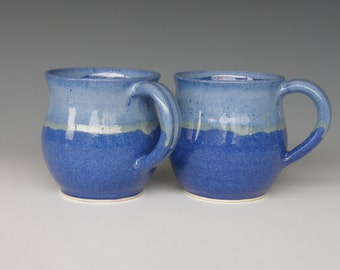 Pair of 12 ounce Mugs. Stoneware. Glazed in three different blues.