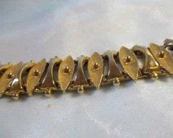Gold Tone Geometric Design Link Bracelet, Fold over Clasp