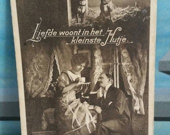 Antique sepia postcard dogs and couple Dutch Amsterdam
