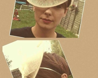 Tilted dipped faacinator in cream/beige Hairband or comb. Races, mother of the bride or guest