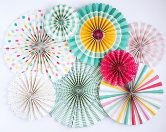 Teal, pink, and yellow pinwheel Fans. Set of 8. Light pink pinwheels. Turquoise rosettes. Bright pink pinwheel fan dessert table backdrop.