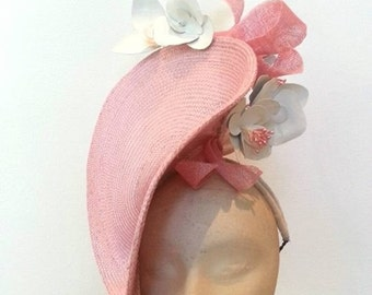 Handmade millinery dusty pink fascinator for Spring Racing, with leather flowers