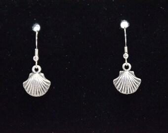 Silver she'll earrings.