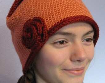 Crocheted orange and burgundy hat