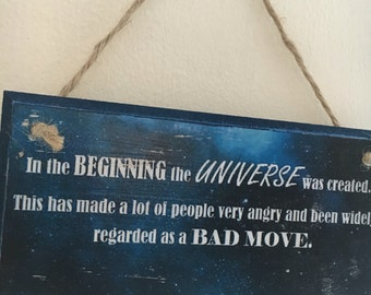 "Douglas Adams fan art ~ Hitchhikers Guide to the Galaxy quote ~ ""in the beginning..."" ~ wall plaque 6x3"""
