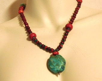 Green stone pendant with coral and glass beads and turquoise chips
