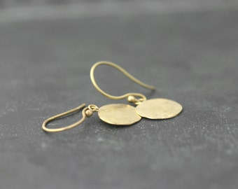 Plate 18 kt gold earrings with