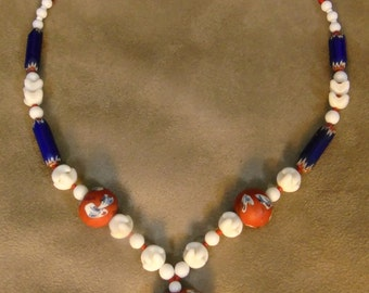 SNOW WHITE ,handmade necklace with African traded Facebeads and Chevronbeads.