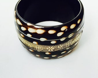 Polka dotted bangle with a metallic strip