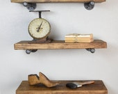 Three Industrial Floating Shelves combo with plumbing pipe supports. Urban Industrial Pipe Floating Shelf