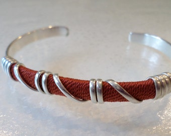 Silver Tone Orange Wrap Design Adjustable Cuff Bracelet.