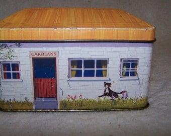 Carolan's creamery tin, building shaped tin box