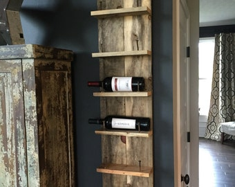 Horizontal reclaimed wood wine bottle holder with railroad nails. 6 shelves available as well as 3 shelves.