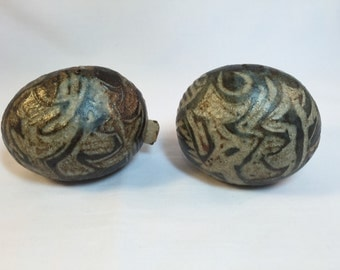 Hand carved pottery salt and pepper shakers