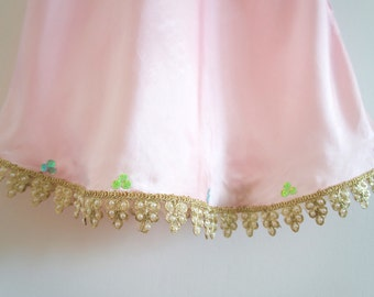 Pale pink silk slip dress with a delicate gold and pearl Indian trim and hand-sewn pastel sequin embellishment