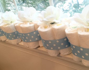 6 Blue Flower Baby Shower Diaper Cake Centerpieces.  Diapers for the Mom-to-Be!