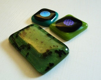 Set of 3 fused glass cabochons in various greens & black, with dichroic details