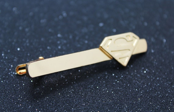 gold superman tie clip by singsotime on etsy