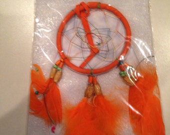 Older orange dream catcher with saying included in package