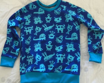Handmade Size 3 Aqua monsters on blue sweater