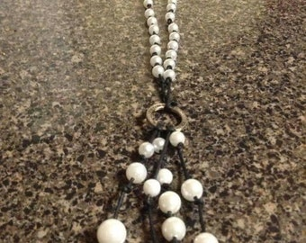 Pearl and hollowed coin necklace