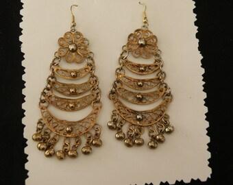 Large brass color earrings