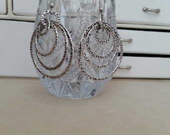 Glamorous Various Sized Patterned Silver Hoops