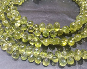 Peridot Natural faceted drop shape , length of strand 8 Inch and different sizes