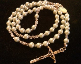 Light green and clear bead rosary.