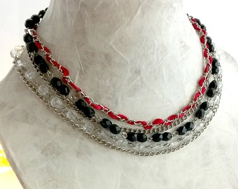 Multi-stranded necklace with ribbons and costume beads