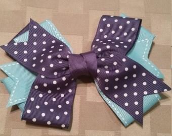 Blue pinwheel bow
