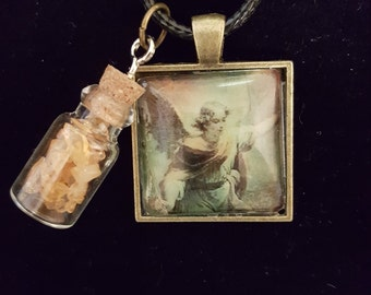 Angel Pendant With a Bottle of Citrine Crystals