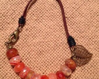 Orange glass faceted rondel bracelet
