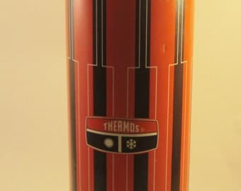 Vintage Thermos Brand Hot and Cold drink holder with cup.