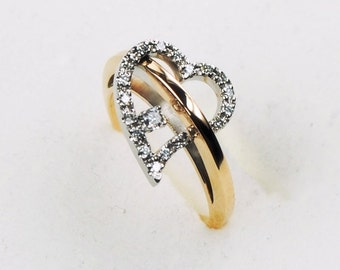 a heart gold and diamond ring