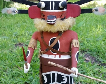 """Vintage , hand carved Hopi """"Ogre"""" Kachina doll with ornate feathered and beaded head dress."""