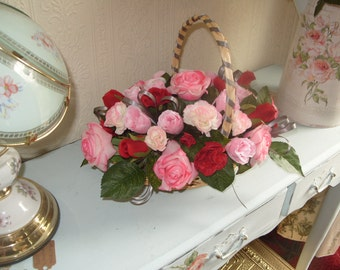 Pink and Red Rose display silk  Posy Basket,    with Carnations and sage green ribbons.