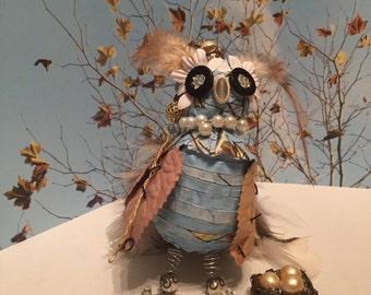 Queen Owl with Her Nest