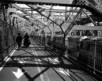 Couple on Williamsburg Bridge, NYC.
