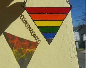 Stained glass rainbow flag triangle