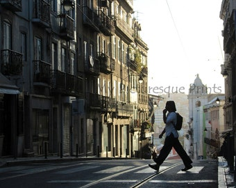 street in Lisbon in Portugal with walking Person